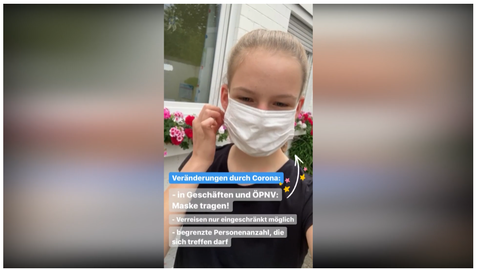 Mädchen mit Mundschutz