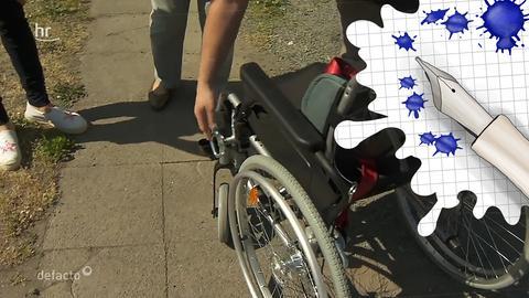 Rollstuhl und Grafik