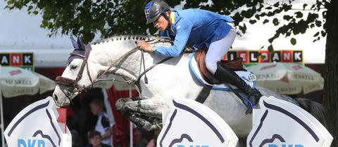 Christian Ahlmann mit seinem Pferd Clintrexo Z