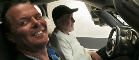 """""""Puls 180"""": Prinz Marcus von Anhalt und Thomas Adam in einem Auto"""