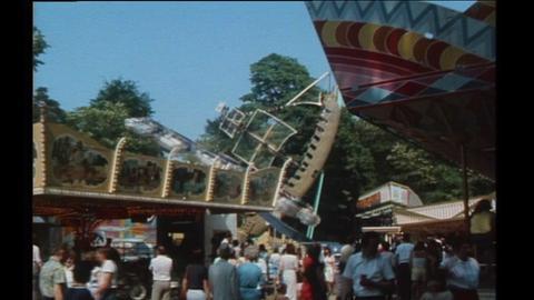 Der Wäldchestag 1983, viele Menschen und mehrere Fahrgeschäfte.