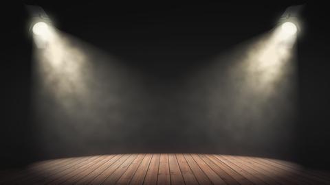 Leere Bühne, die von zwei Scheinwerfern angestrahlt wird.