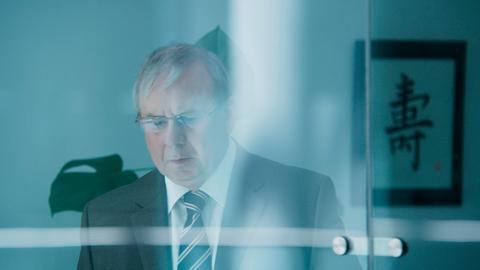 "Szene aus dem Dokudrama ""Lehman. Gier frisst Herz"" mit Joachim Król"